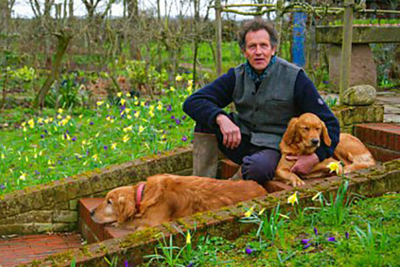 Monty Don in his garden with his dogs